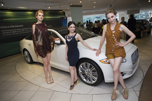 Lidia Amirova (center) poses with two models wearing her designs next to the new Jaguar at Manhattan Automobile Company during an event celebrating New York City's 8th Annual Russian Heritage Festival