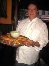 08-14-13 Chef Alonso Tello with a tray of his special hors d'oeuvres, including duck confit, shrimp roll and cheese sticks at a tasting at Trois Canards. 265 West 20th St. Tuesday night 08-13-13