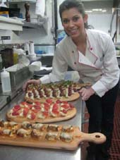03-29-12 Chef Kristin Sollenne displays four types of her delicious hors d'oeuvres at a food tasting party at Vucciria. 635 Ninth Ave. Wednesday night 03-28-12