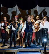 Cast of Cyrano with Gabriel Barrie in the center
