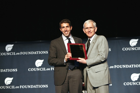 Adam Coyne, Director of Public Affairs at the Robert Wood Johnson Foundation (left) accepts the 2010 Critical Impact Award from Steve Gunderson, President and CEO of the Council of Foundations during the Council on Foundations annual conference in Denver, Colo., on behalf of their support and collaboration with the Hitachi Foundation for launching Jobs to Careers, a health care frontline worker program