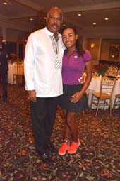 Vice Chancellor Sir Hilary Beckles and Kyra Cox (golfer) .  Photo by:  Rose Billings/Blacktiemagazine.com
