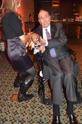 Buttons The pup with Honoree Senator Bob Dole.  Photo by:  Rose Billings/Blacktiemagazine.com