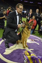 Handler Owner Kent Boyles with his German Shepherd Rumor.  Photo by:  Rose Billings/Blacktiemagazine.com