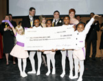 John and Madlyn singer, Art Advisors, LLC (second row 3rd and 4th from left) presented $1,000,000 check to youth of the All Stars Project at 2009 gala benefit at Lincoln Center.  All Stars Project president and CEO, Gabrielle L. Kurlander (second row, 5th from left) with All Stars Project Hall of Fame Honorees, Lynee Turley (second row, left), Edward C. Malmstrom, Bank of America Securities/Merrill Lynch & Co., (back row, partially obscured) and James Turley (second row, second from left), Chairman and CEO of Ernst and Young looking on