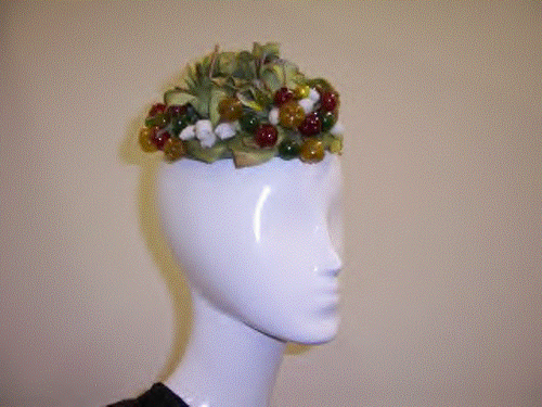 1950s Hattie Carnegie Fruit & Flower Pixie Hat made out of celluloid that was donated to the Museum of Lifestyle & Fashion History from