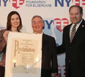 Executive Director Tanya Figelman holds a proclamation issued by the New York City Council, with Chairman Michael Tietz and City Councilmember Rory Lancman of Queens. at the New York Foundation for Eldercare Dinner 2014.  Photo by:  Margarita Volfson