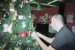 Macy's Visual Manager Michael Steele decorates Barbie Christmas Tree at the Museum of Lifestyle & Fashion History