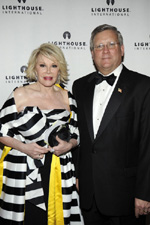 Joan Rivers accompanied by Lighthouse International President and CEO Mark Ackermann before she hosts the gala's silent auction