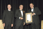 Caption: (left) Brother James Gaffney, FSC, President of Lewis University, and (right) James Goodwin, Chair of the Lewis University Board of Trustees, present the annual Signum Fidei Award to William Rybak, Lewis alumnus and Chair Emeritus of the Lewis University Board of Trustees, September 12 at the Palmer House Hilton Chicago.
