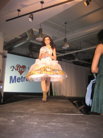 "A model struts down the runway in a dress from Nina Vishneva's ""Metrocouture"" collection at Manhattan Automobile Company during a Fashion Showcase of NYC's hottest Russian designers to kick off Immigrant Heritage Week."