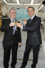 Jeff Koons and Jim O'Donnell, President of BMW North America, toast the announcement that Koons will create the 17th BMW Art Car at Koons' Manhattan studio, Tuesday, February 2, 2010.  Koons  joined an illustrious group of artists that included