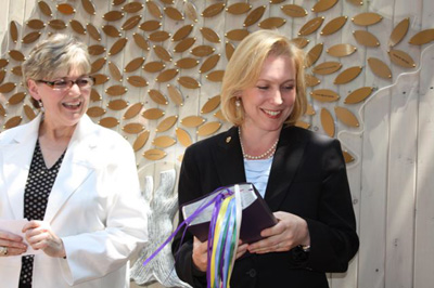 Deborah Jones Director of the Bowery Mission Women's Center presents Honoree NY Senator Kristen Gillibrand with a Bible