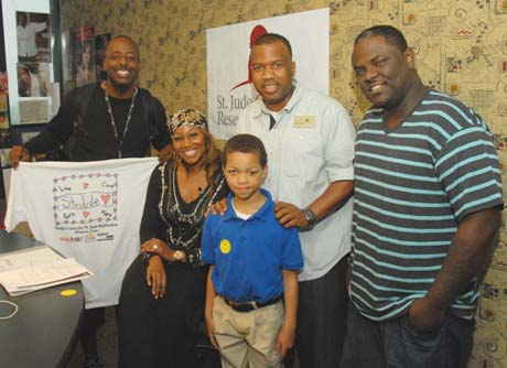 St. Jude patient Emmanuel with Yolanda Adams Morning Show crew during the 5th annual Radio Cares for St . Jude Kids event