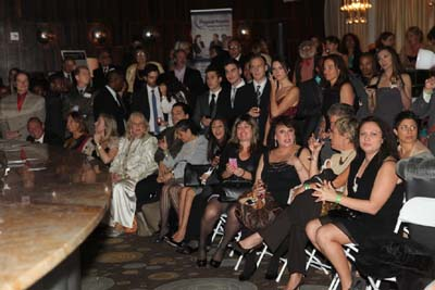 Guest Pictures in one side watching the fashion show with Andrea Spring Managing Director Blue Star Jets;