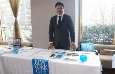 Husain Ansar with his sponsorship table