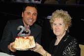 �Man of the Year� honoree, Oscar De La Hoya holding a celebratory 25th Anniversary cake with PAFH.  Photo b:  Vince Bucci