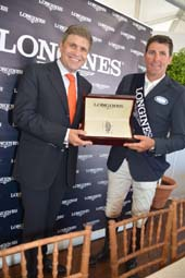 Longines Vice President Head of International Marketing Juan-Carlos Cappelli and Paul O'Shea $40,000 Winner Jumper.  Photo by:  Rose Billings/Blacktiemagazine.com
