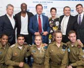 David Foster; Seal; Arnold Schwarzenegger; Cheryl and Haim Saban; and Consul General of Israel in Los Angeles Sam Grundwerg with IDF soldiers