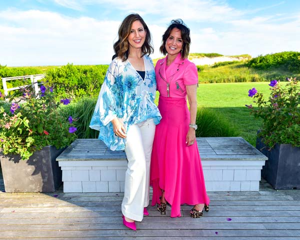 Camille Zamora and Margie Loeb attend Roberto Cavalli Beach Magazine Hamptons Event at Private Residence on July 26, 2018 in Southampton, New York.