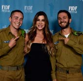 Siggy Flicker, star of Bravo hit television show The Real Housewives of New Jersey, with Israeli soldiers at the FIDF National N.Y. Gala Dinner