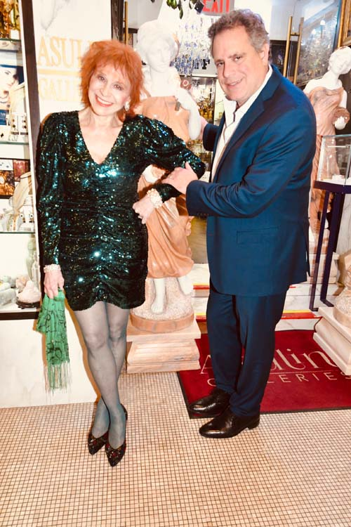 We all should be Goddesses, says Dr. Judy here with the Goddess of Summer statue at Asulin galleries with owner Mario Assoulin.  Photo by:  Rose Billings/Blacktiemagazine.com