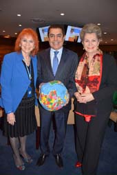 Dr. Judy Kuriansky, Psychology Professor at Columbia University Teachers College and UN NGO Representative of the International Association of Applied Psychology; H.E. Mr. Nassir Abdulaziz Al-Nasser, High Representative for the United Nations Alliance of Civilizations and former permanent representative of Qatar to the UN, holding a soft globe called Hugg-A-Planet, made by toy manufacturer Robert Firenze as a symbol of world peoples coming together; and Her Excellency Ambassador Katalin Bogyay; Permanent Representative of the Mission of Hungary to the UN;.  Photo by:  Rose Billings/Blacktiemagazine.com