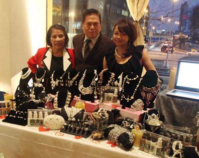 Gloria Cabrera of Gloria Cabrera Salon and Spa & Jewelry, Marshall Factora and Tess Medina in there Display table as an sponsor.