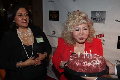Gloria Cressler February celebrant with her birthday cake