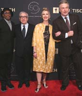 Dean Allyson Green (in yellow) walks the red carpet with alums Spike Lee, Martin Scorsese and Alec Baldwin