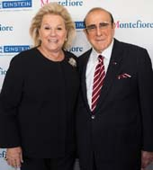 Women�s Division President Carol Roaman with 2016 Spirit of Achievement Honoree Clive Davis