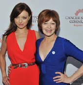 Francesca Eastwood (left) presented the Gilda Award to her mother Frances Fisher (right).  Photo by:  Vince Bucci