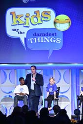 Host Jay Mohr on stage with BGCA Club members conducting a segment of