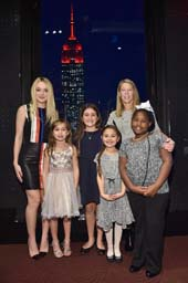 Dakota Fanning; Colette Prainito; Miracle Jones; Kate Papadatos Antonella Garcia. Photo by:  Mike Coppola for Save the Children