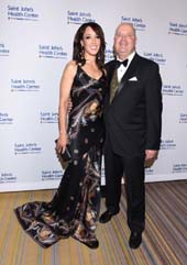 2016 Caritas Award honoree Jennifer Beals and her presenter Dr. John Robertson