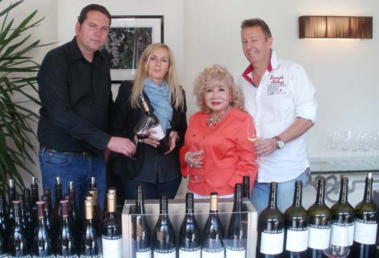 Toni Bauer and Gudron of Anton Bauer Winery, Gloria T. Cressler and Robert Lester  at the winery for the wine festival in Austria